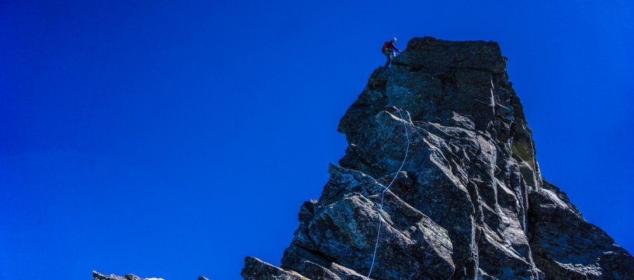 Topping out on a steep section of the West Ridge.
